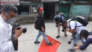 Tibetan Activist Tenzin Tsundue stomps on the Chinese flag to protest against the PLA incursion into Ladakh and the death of 20 Indian soldiers. (June 18, 2020 Phayul photo-Kunsang Gashon).