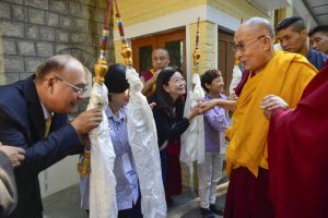 His Holiness the Dalai Lama being greets by his devotees.