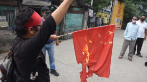Activists burn the Chinese flag at McLeod Ganj's main square protesting Chinese incursion in Ladakh and killing Indian soldiers. (June 18, 2020 Phayul photo-Kunsang Gashon).