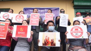 Representatives of five Tibetan NGOs holds placards to express solidarity with India and Indian forces at the Indo-Tibetan border. (June 18, 2020 Phayul photo-Kunsang Gashon).