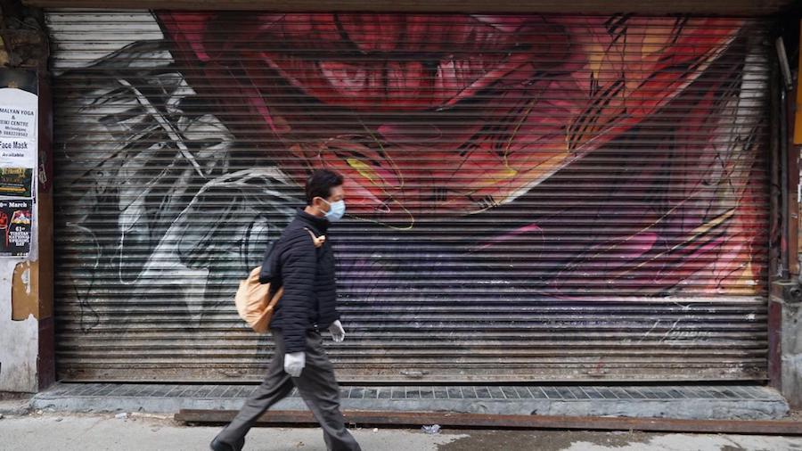 A man walks the deserted streets of McLeod Ganj. April 2020. Phayul photo-Tenzin Leckphel