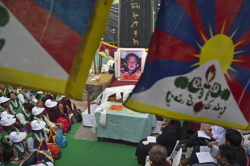 A portrait of the 11th Panchen Lama is seen as exile Tibetans mark his birthday in Dharmshala in April 2019 (AP Photo-Ashwini Bhatia)