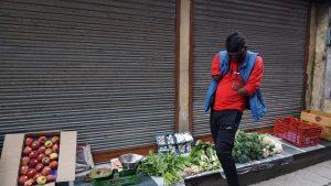 A vegetable seller attending a call. April 21, 2020. Phayul photo-Tenzin Leckphel.