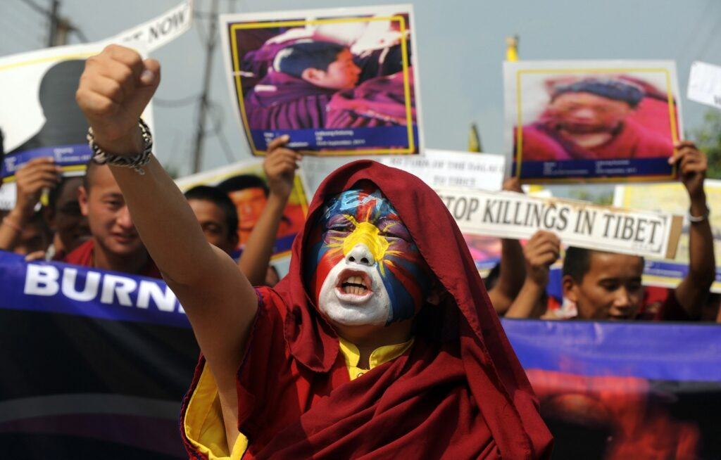 Tibetan monks during a protest rally in Siliguri on November 3, 2011. AFP PHOTO/Diptendu DUTTA