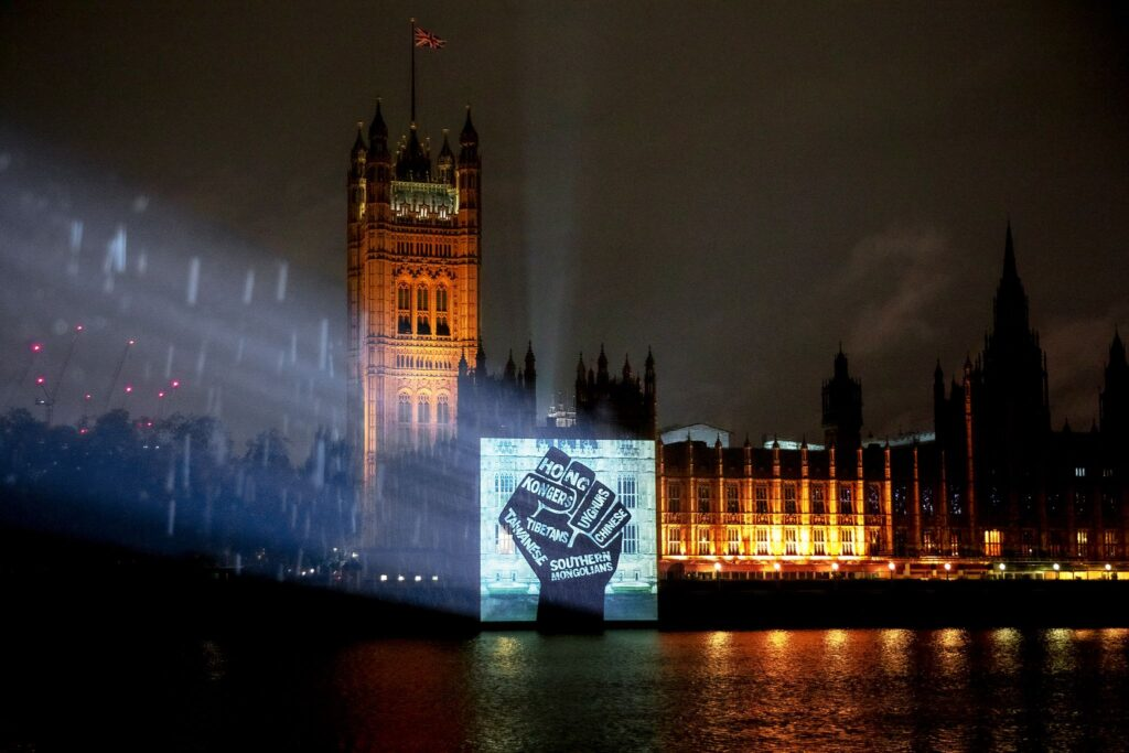 Activists in London protested via night projection onto the British parliament on Thursday (Photo- Free Tibet)