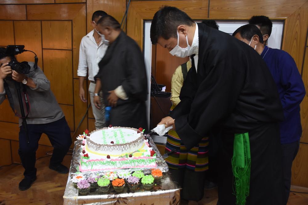 CTA President cutting a celebratory cake at Gankyi hall on HHDL's 85th birthday (Phayul Photo Kunsang Gashon)