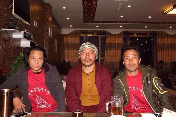 Choekyi flanked by former Tibetan political prisoners wearing the T-shirts made for Dalai Lama's 80th birthday by Choekyi. Photo-TCHRD