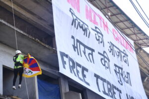 """As the Chinese Communist Party (CCP) celebrates its 99th anniversary, Activist group Students for a Free Tibet, India unfurled a large banner that read """"Down with China"""" and """"Tibet's independence, India's security"""" urging the international community to recognise Tibet's independence and assert its nationhood as China's territorial aggression is on the rise globally. July 23, 2020 in McLoed Ganj, Dharamshala, India. Phayul Photo by Kunsang Gashon."""