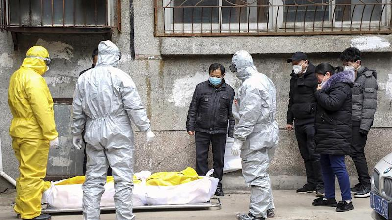 Frontline funeral workers remove the body suspected to have died from COVID-19 at Wuhan in Feb 2020 (Photo- AP)