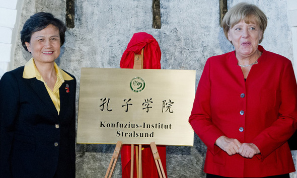 German Chancellor Angela Merkel (R) with Cheif Executive of CI Headquarters Xu Lin (L) at the opening event of Stralsund CI in Germany in Aug. 2016 (Photo- China Daily)