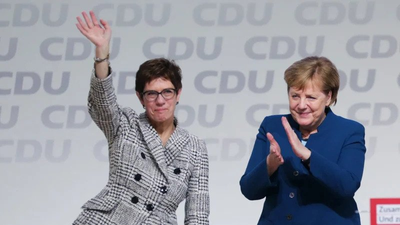Germany's Defence Minister Annegret Kramp-Karrenbauer with Chancellor Angela Merkel in 2018 (Photo- The Sydney Morning Herald)