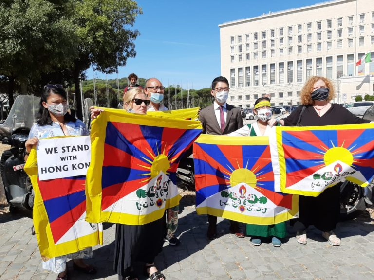 HK activist Nathan Law with supportes of Tibet and Hong Kong during the protest against the visiting Chinese Foriegn Minister Wang Yi on Tuesday (Photo- CTA)