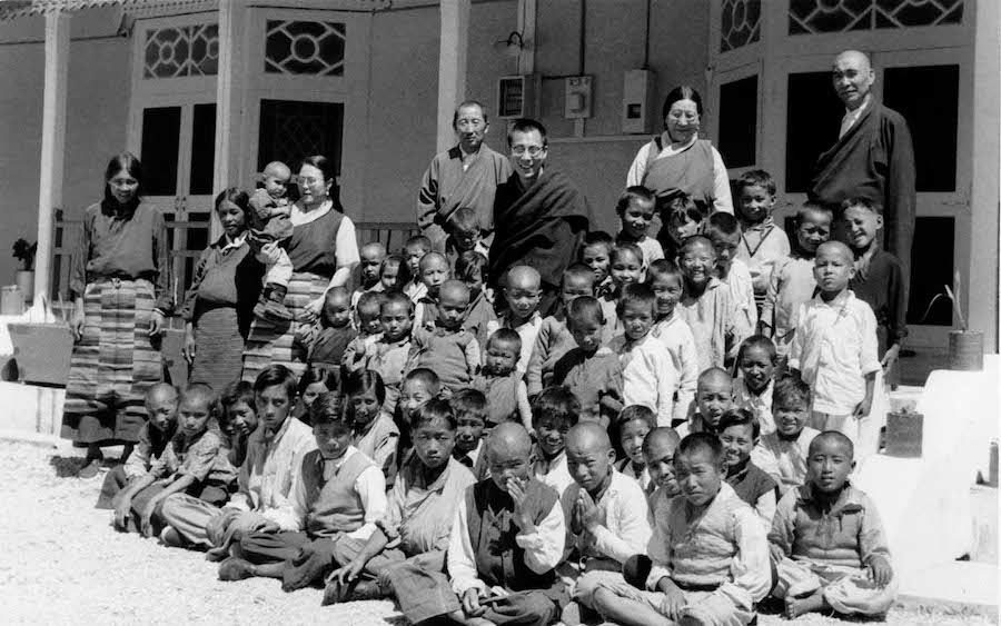 His Holiness the Dalai Lama with children of Tibetan road-builders in Jammu at Swarg Ashram in Dharamshala (OHHDL)