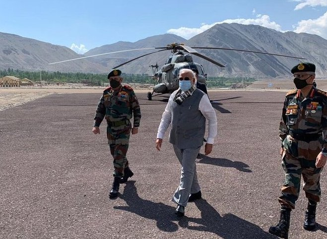 Indian PM Narendra Modi flanked my military top brass at Leh on Friday (PTI)