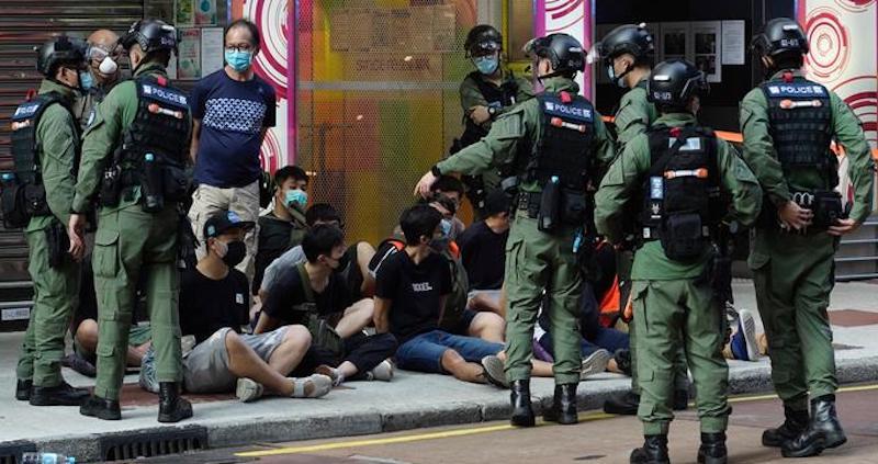 Police detain a group of protestors in Hong Kong in June 2020 (Photo-AP)