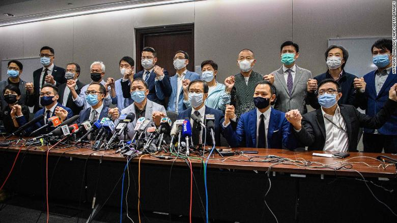 Pro-democracy lawmakers join hands in soldarity with the four ousted MPs at a press conference in Hong Kong on Wednesday (Photo- CNN)