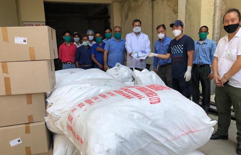 Staffs of the Dalai Lama Trust donates 500 PPE kit sets to the Tanda Hospital in Kangra District. May 12, 2020. Photo-Facebook
