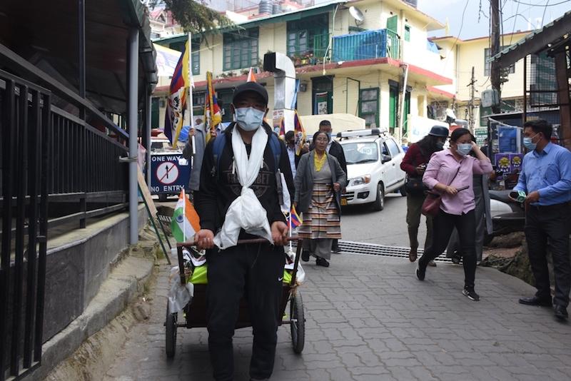 Tenzin Dhondup at Dolma square with activits following him in a show of solidarity on Monday (Phayul photo- Kunsang Gashon)