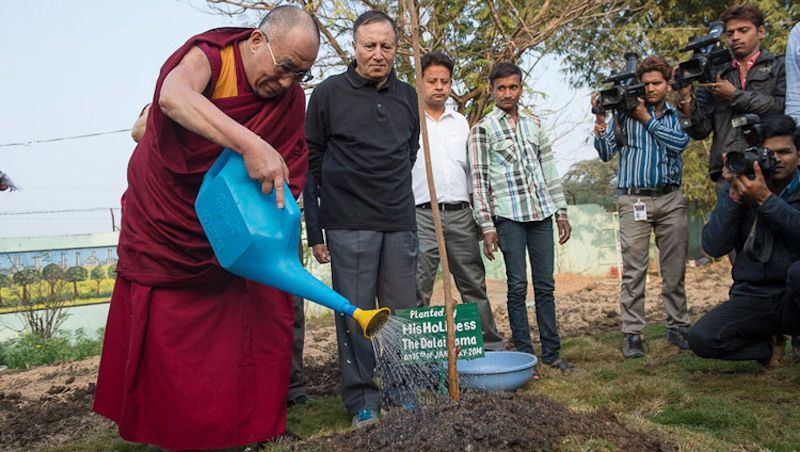 Tibetan leader His Holiness the Dalai Lama planting a sapling (OHHDL)