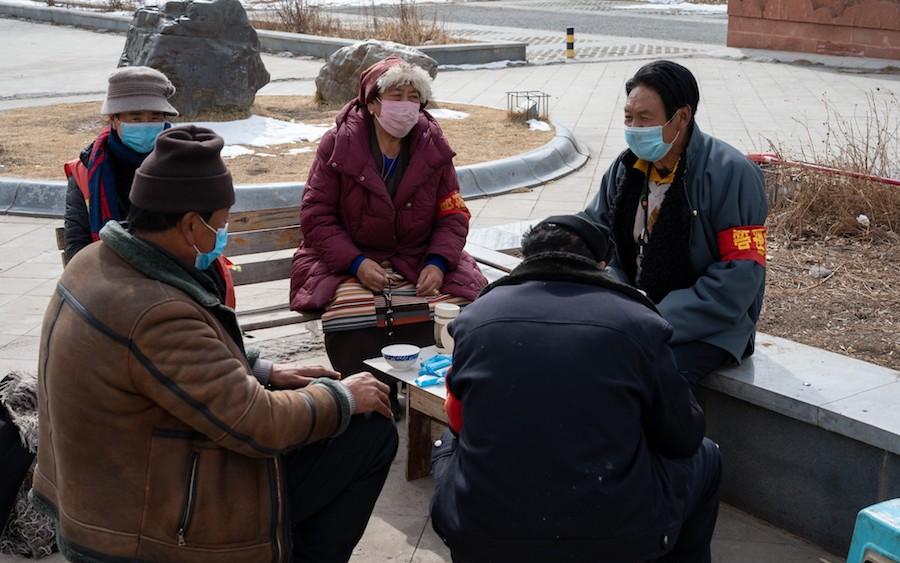 Tibetan virus prevention workers take a break in Garze, Occupied Tibet. Photo-LA Times:Eleanor Moseman