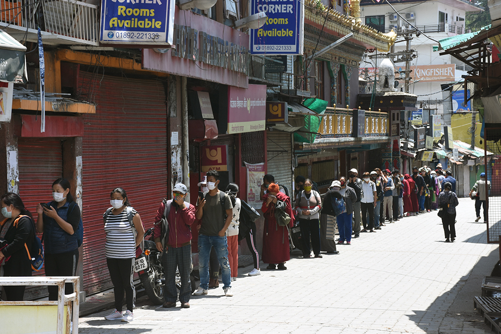 Tibetans in Dharamshala line up to recieve ration and other essentials. May 1, 2020. Phayul photo-Kunsang Gashon