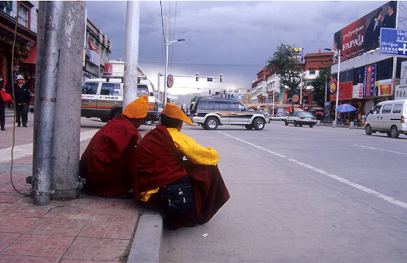 Two nuns by a street in Lhasa city (Photo courtesy Vijay Kranti)