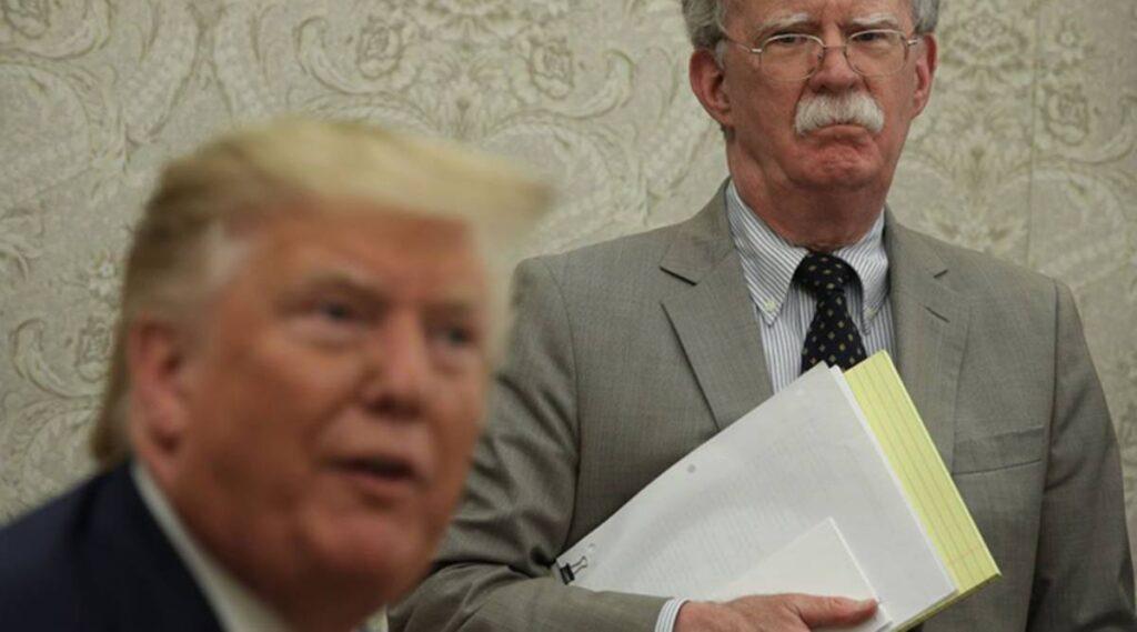 US President Donal Trump and his former NSA Advisor John Bolton (Photo courtesy Bloomberg)